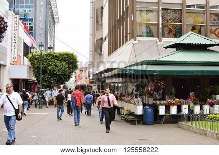 San Jose Costa Rica - August 18 2015: People are seen walking down the streets in downtown of San Jose Costa Rica on August 18 2015