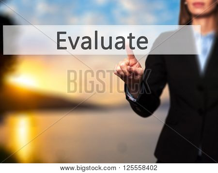 Evaluate - Businesswoman Hand Pressing Button On Touch Screen Interface.