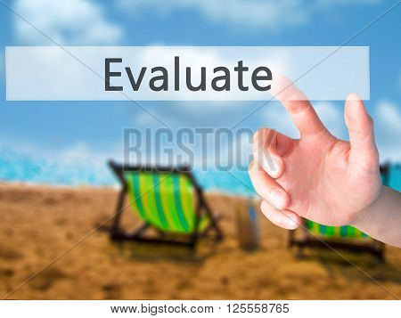 Evaluate - Hand Pressing A Button On Blurred Background Concept On Visual Screen.