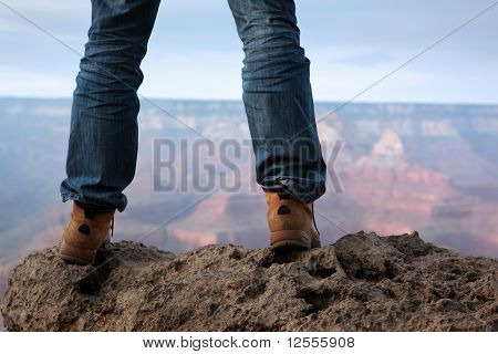 Male Feet Standing On Edge Of A Cliff