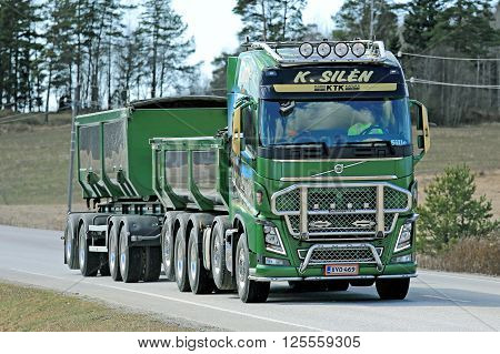 KARJAA, FINLAND - APRIL 10, 2015: Green Volvo FH16 750 for construction of K. Silen moves along road. The customized FH is known from Finnish truck shows.