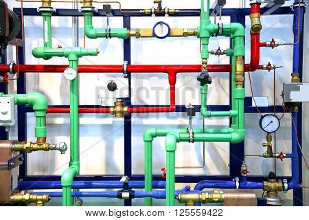 Colored pipes and heating system demo as a background