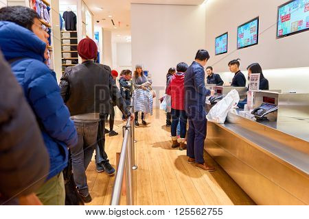 NEW-YORK - MARCH 20, 2016: inside of Uniqlo store. Uniqlo Co., Ltd. is a Japanese casual wear designer, manufacturer and retailer.