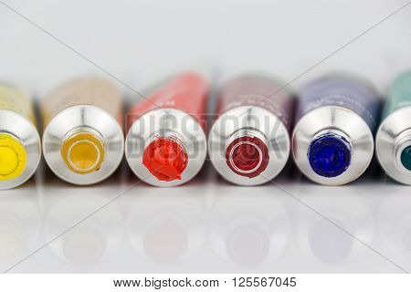 Many Colorful Paint Tubes Closeup
