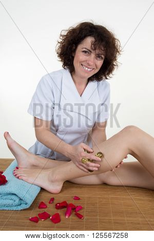 Picture Of A Physio Therapist Trying To Fix The Leg Over White Background