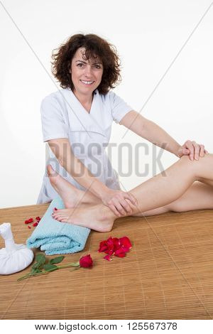 Woman Getting Massage Treatment At Spa Center