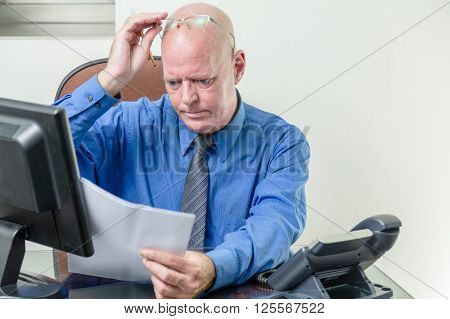 Executive Comparing Computer And Written Notes
