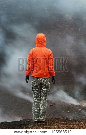 Man in the volcanic landscape. Iceland places.
