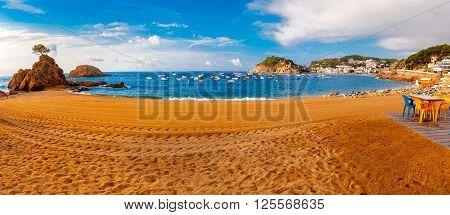 Sand beach Platja Mar Menuda, Badia de Tossa bay and fortress Vila Vella in the morning, Tossa de Mar on Costa Brava, Catalunya, Spain