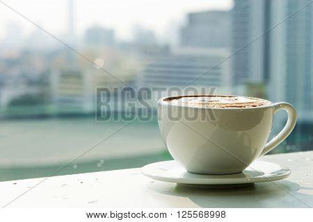 close up coffee cup on rim of window vie urban
