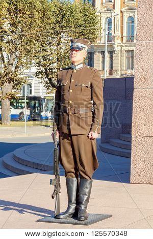 Riga, Latvia - 15 October, 2015: Soldiers guard of honor in the form and with an automatic rifle at a post on the Independence Square.