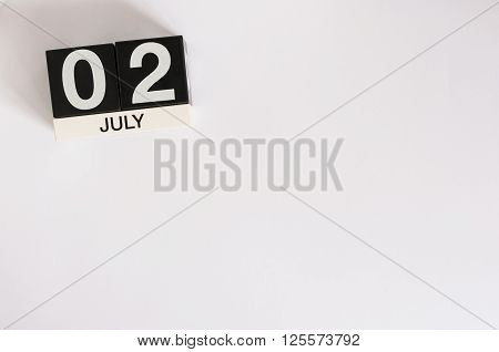 July 2nd. Image of july 2 wooden color calendar on white background. Summer day. Empty space for text. World Sports Journalists Day. UFO DAY.