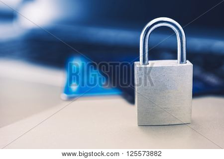 Secured Payments Concept with Metallic Padlock and Credit Cards in the Background. ** Note: Shallow depth of field