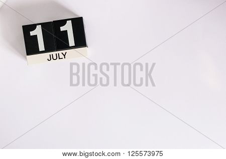 July 11th. Image of july 11 wooden color calendar on white background. Summer day. Empty space for text. World Chocolate Day.