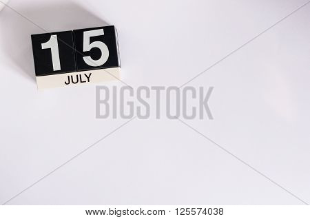 July 15th. Image of july 15 wooden color calendar on white background. Summer day. Empty space for text.