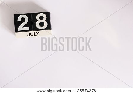 July 28th. Image of july 28 wooden color calendar on white background. Summer day. Empty space for text. World Hepatitis Day.