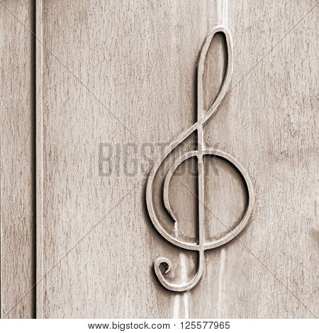 treble clef - on the old textured metal surface