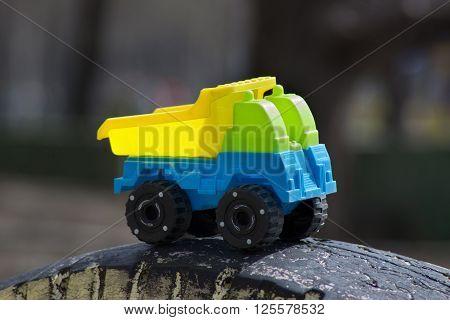 children's toy - the car truck. indistinct background