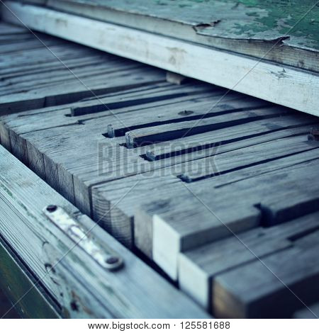 Old wooden Piano keys. Close up. Broken piano. Aged photo. Broken piano keys. Vintage filter. Decay. Old musical instrument.