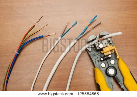 wire stripper, pliers and cable ferrules ready to apply