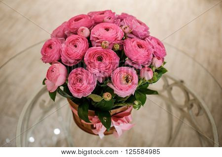 Pink persian buttercup flowers ranunculus bouquet on table