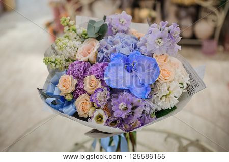 Bouquet of white and blue flower on table