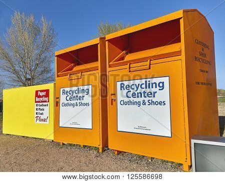 Recycling center collection bins for paper clothing disposal waste management