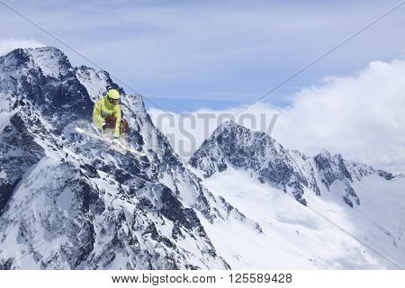Ski rider jumping on mountains. Extreme ski freeride.