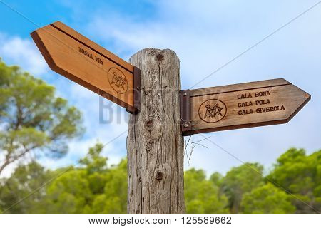Signpost of hiking trails to Tossa de Mar, Cala Pola, Cala Bona and Cala Zhiverola, Costa Brava, Spain