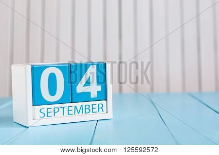 September 4th. Image of september 4 wooden color calendar on white background. Autumn day. Empty space for text.