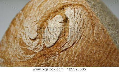 Bread - older than the Pyramids. Dragon Eye. A loaf of bread in the form of the head and eye of the dragon - a symbol of antiquity and sacredness of technologies for the production of bread. The danger of the abuse of farinaceous foods.
