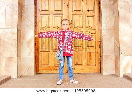 Schoolgirl Before Big Wooden Door