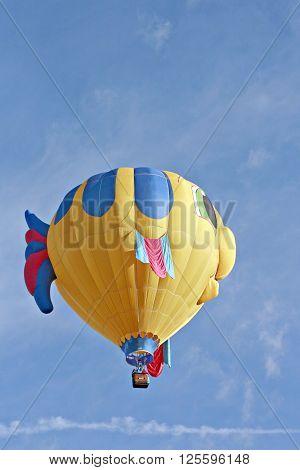 ALBUQUERQUE, NM OCTOBER 4, 2008Yellow fish hot air balloon aloft at Albuquerque Hot Air Balloon Festival October 4, 2008