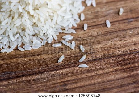 Closeup of rice on wood background