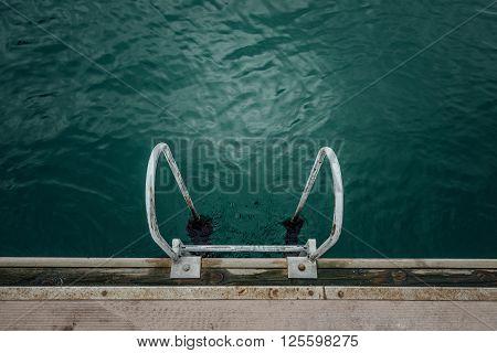 Ladder With Algae Into Sea Wood Mooring