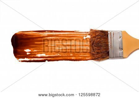 paint brush and dab of chocolate sauce. chocolate sauce. texture. sample and brush isolated on white background