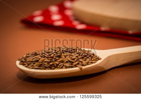 Linseed on a wooden spoon on the table