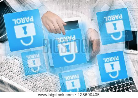 Woman working with tablet-pc and icons security on virtual display. Technology, internet and networking concept.