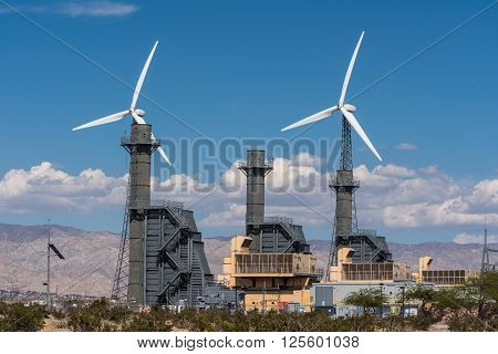 Rows Of Wind Turbines And A Power Station