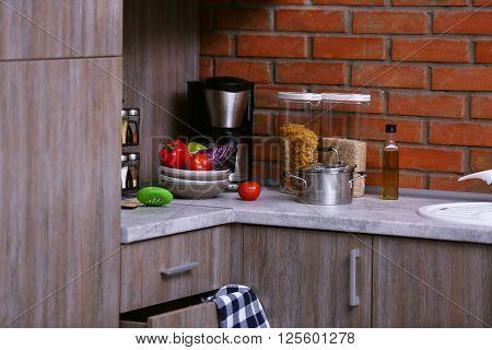 Modern kitchen furniture, coffee maker and utensils