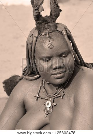 SWAKOPMUND, NAMIBIA OCTOBER 09, 2014: Unidentified woman from Himba tribe. The Himba are indigenous peoples living in northern Namibia, in the Kunene region of South-West Africa on october 09 2014