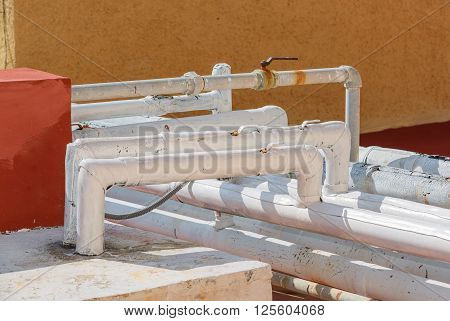 nice closeup view of old degrading communication gas pipes on top of the roof