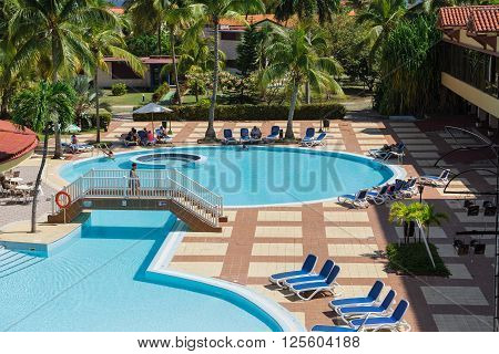 Varadero island, Villa Cuba, Cuba, Apr. 30, 2014, beautiful inviting amazing view of Villa Cuba resort swimming pool with turquoise azure water