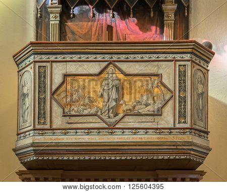 Verona, Italy - December 15, 2015: Detail of a pulpit with painted jesus shepherd of souls.