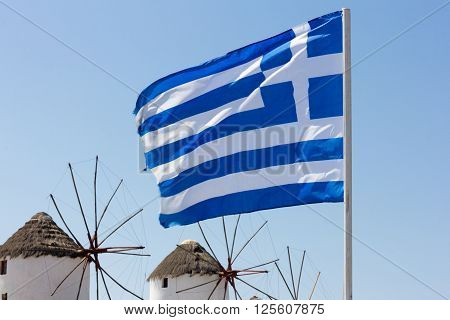 Greek flag and windmills in Mykonos Greece