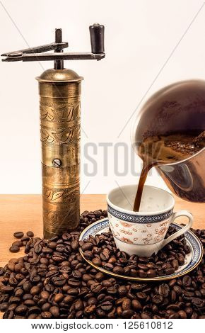 Beautiful Old Coffee Cup With Coffee Beans With Old Coffee Grinder