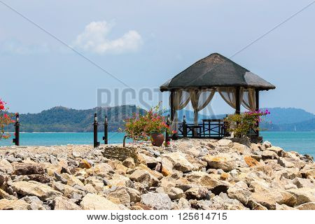 Little hut on a pier with table and chairs for a romantic dinner on Langkawi island Malaysia