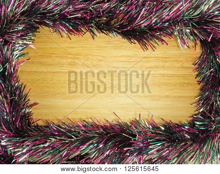Colorful streamer on the wooden board background