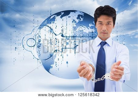 Portrait of a businessman with handcuffs against digital blue key with matrix and a planet
