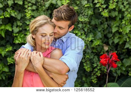 Romantic couple embracing in front yard